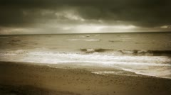 Cinematic Sepia toned overcast beach scene Stock Footage