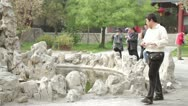 Stock Video Footage of Dai Temple Taian China Chinese tourists walking around rock pond