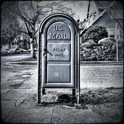 US mailbox on neighborhood corner - stock photo