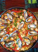 Pan of mussel paella Stock Photos