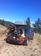 Station wagon loaded for vacation in remote area Stock Photos