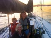 Caucasian grandmother and grandchildren on sailboat Stock Photos