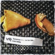 Open fortune cookie with fortune Stock Photos