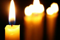 Candle in focus - stock footage
