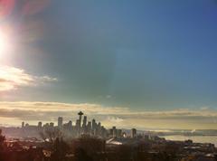 City skyline against cloudy sky Stock Photos