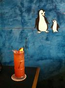 Tropical drink at table with penguin illustration Stock Illustration