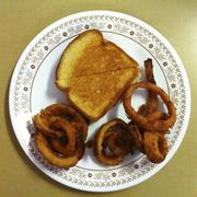 Plate of grilled cheese and onion rings Stock Photos