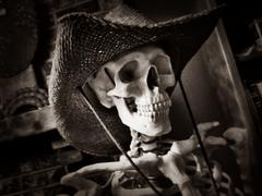 Skeleton wearing cowboy hat - stock photo