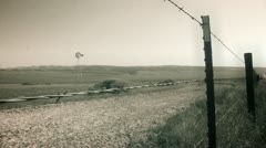 Vintage Film Grain Barbed Wire Windmill Farm Stock Footage