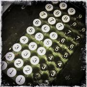 Close up of buttons on vintage register Stock Photos