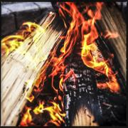 Fire blazing in pit - stock photo