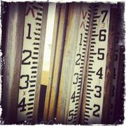 Distressed photograph of oversized rulers Stock Photos