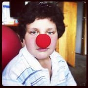 Boy wearing red clown nose - stock photo