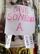 Sign reading 'Give someone a' with tabbed options - stock photo