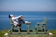 Young man sitting on the bench Stock Photos