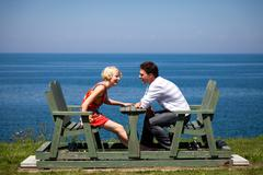 romantic couple sitting on the bench - stock photo