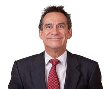 business man in suit with cheesy grin - stock photo