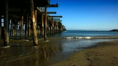 Perspective shot looking down a pier Stock Footage