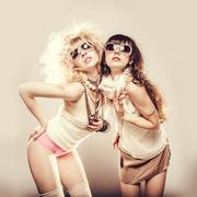 Caucasian women posing together - stock photo
