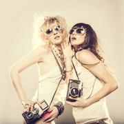 Caucasian women posing with cameras Stock Photos