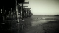 Vintage Styled Beach Scene with Pier Stock Footage