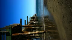 Vertical Shot of Pier looking out to sea Stock Footage
