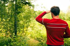 lost young man in nature - stock photo