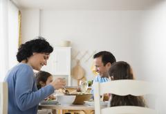 Family eating together at table - stock photo