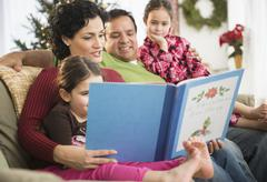 Stock Photo of Family reading together on sofa