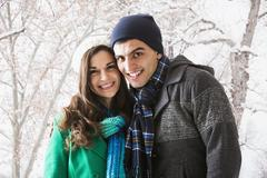Smiling couple walking in show Stock Photos
