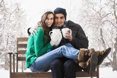 Couple having coffee together in snow Stock Photos