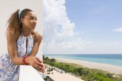Mixed race woman overlooking beach Stock Photos