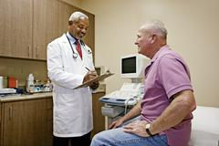 Doctor talking to patient in office Stock Photos