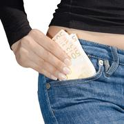 woman's hand holding a bundle of banknotes isolate - stock photo