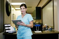 Caucasian nurse using digital tablet in office Stock Photos