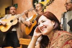 Hispanic woman in restaurant with traditional band Stock Photos
