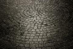 Dark wet cobblestone background Stock Photos