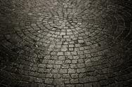 Stock Photo of dark wet cobblestone background