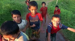 Laughing nepali and refugee tibetan children and pursuing the camera. Stock Footage