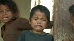 Little crying nepali boy and his friends. - stock footage