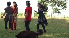 Nepali and refugee tibetan girls playing the game of blind man's bluff. Stock Footage