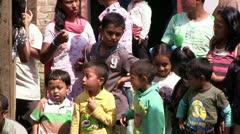 Nepali children and tibetan refugees waiting during Bhairab festival in Nepal. Stock Footage