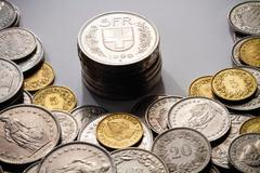 Spot Light on Swiss Francs - stock photo