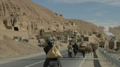 people walking on a road, Afghanistan - stock footage
