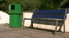 Empty bench and litter bin Stock Footage