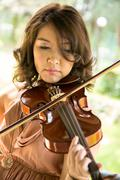 young woman playing violin - stock photo
