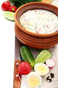 Preparation of a cold soup with kefir. Stock Photos