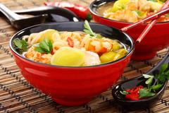 chinese fish soup with shrimp. - stock photo