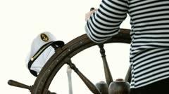 Sailor turns steering wheel - stock footage
