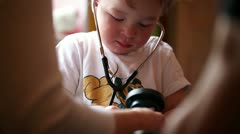 Boy plays a doctor. Stock Footage